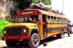 """Many buses in Guatemala, lovingly called """"chicken buses"""" by most foreigners, are old school buses from North America. Their service is slow and uncomfortable, but they can get you to the remotest of villages Old School Bus, School Buses, Central America, North America, Nice Bus, Honduras, Belize, Bus Coach, Bus Ride"""