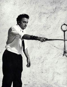"""Federico Fellini on the set of """"8½"""" (1963). Photo by Tazio Secchiaroli"""
