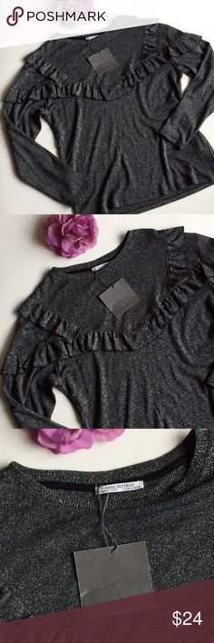"""NWT ZARA Ruffle Shimmer Top Sweater Size Medium NWT. Ruffle detail on the silver shimmer top adds modern sophistication to any outfit. Comfy and stretchy styling. 25"""" length, 20"""" bust, 24"""" sleeve. Thanks for shopping my closet! Zara Tops"""