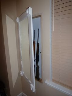 Picture of Hidden in wall Gun Cabinet with Hidden keypad. Good for things, other than guns, too.