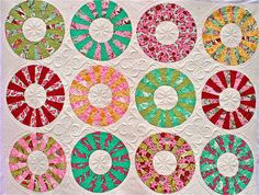 Dresden Plate... looks like candy.. with amazing quilting!