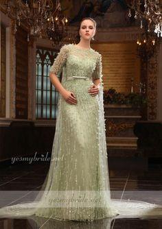 986452e21 ثوب سهرة طويل بلون أخضر فاتح و رقبة مستقيمة نصف كم شفّاف مزين بالخرز  $1,260.00 http · Evening Gowns ...