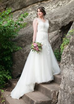 This floor length open back wedding dress was made delicate lace and tulle. Illusion neckline was made of sweetheart bodice covered with v neck sheer lace applique overlay when backless on this trumpet skirt. Full skirt was finished double with crystal beaded belt on waist.