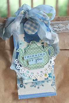Tea pot tag - how beautiful.  I'd actually use this as a card topper - and add a couple of tea bags to the interior as a surprise mini gift, with an inscription about sharing a cup of tea with me, even though we were apart.