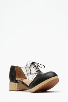 These look hard to walk in.  What a weird shoe!  Charlie Cutout Oxford - Black