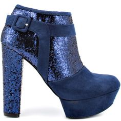 No need for a boring ankle boot this season, go for the glitz in the Amyann.  This G by Guess silhouette brings you a soft blue fabric upper complete with a burst of glitter trim and decorative buckle.  A thick 5 inch block heel and 1 1/4 inch platform finishes off this eye catcher.