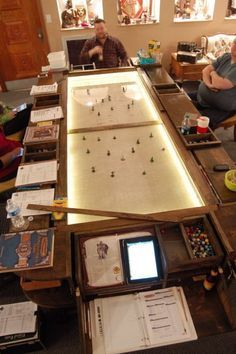 Homemade game table includes lighted battlefield and individual USB charge receptacles at each gamer's station.