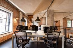 This outstanding space includes such a special details as high grain silo ceiling, brick walls, huge windows and concrete columns.