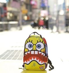 He lives in a pineapple under the sea, absorbant and yellow and porous is he; if nautical nonsense is something you wish, then drop on the deck and flop like a fish...  The Sprayground x Spongebob Deluxe Backpack. Hidden stash pocket