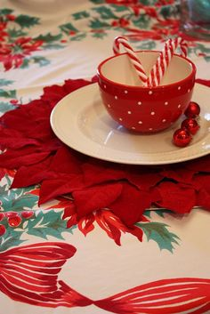 Poinsettia tablecloth...my Grandma has this and it is my favorite Christmas decor at her house, ok 2nd...1st is her ceramic light up Christmas tree :)