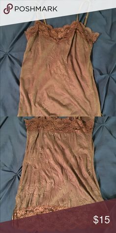 Brown lace tank top Super cute brown lace tank top. I've never worn it. Was given to me, and it's just not my style. But it's really cute. Arden B Tops Tank Tops