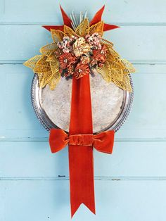 Time for fall wreaths! I love this one. Made from a thrifted tray, ribbon, and leaves. via: http://www.bhg.com/decorating/seasonal/fall/wreaths-for-fall/#page=8