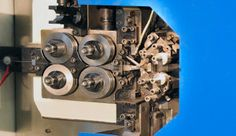In this machine compression springs are being produced. The machine rolls up the spring to the exact right size. Compression Springs, Rolls, Buns, Bread Rolls