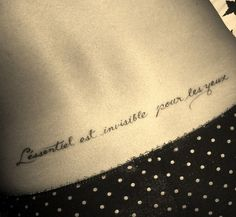 Extraordinary Philosophy Tattoo Quotes on Lower Back - What is essential is invisible to the eye