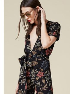 Remember: lower your neckline, not your standards.This is a relaxed fitting jumpsuit with a dolman sleeve and a flare leg opening @reformation