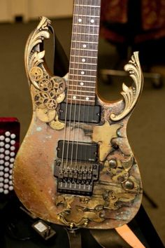 Steam: First of all, what is Steampunk? In the spirit of things, i have decided to put together a quick and basic guide on the Steampunk sub-genre, as 'Steam on Queen,' is this weekend. Guitar Art, Music Guitar, Cool Guitar, Guitar Room, Guitar Painting, Guitar Pics, What Is Steampunk, Steampunk Guitar, Gothic Steampunk