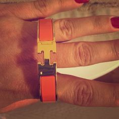 Hermes Authentic Clik Clak Bracelet Orange Hermes Authentic Clik Clak Bracelet Gold & Orange all reasonable offers and trades considered Hermes Jewelry Bracelets
