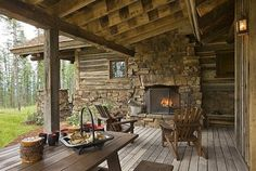 Log cabin w/ outdoor stone fireplace