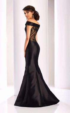 Clarisse 4820. NewYorkDress. Steal the attention at prom in his black  mermaid dress with cap sleeves! 3c1a8f6ed796