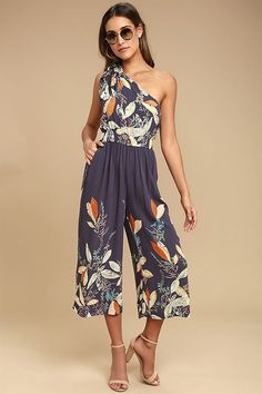 The Free People Island Time Denim Blue Print Midi Jumpsuit is the best thing that ever happened to your vacay! Gauzy woven rayon, with an orange, beige, green, and blue leaf print, shapes a tying, one-shoulder neckline, and elasticized waist. Wide, culotte pant legs with side seam pockets complete this festive look!