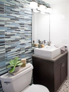 To enhance the beach house theme in this family home, contractors Anthony Carrino and John Colaneri designed this bathroom with a sea glass tile wall, along with a new modern sink and vanity, as seen on HGTV's Cousins On Call. Bathroom Interior Design, Kitchen Interior, Glass Tile Bathroom, Glass Tiles, Bathroom Fixtures, Bathroom Inspiration, Bathroom Ideas, Bath Ideas, Bathroom Goals