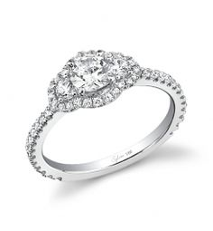 Style SY394S  1-Carat Round Brilliant Diamond Engagement Ring    This magnificent platinum three-stone engagement ring features a 1-carat round brilliant center diamond. Accompanying the center are two 0.16-carat round brilliant side diamonds and round diamonds surrounding the three stones and streaming down the shank sides for a total weight of 0.57 carats.
