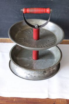 Pie Tins repurposed with an old tool handle.  Such a fun idea - and easy to find at the thrift store!