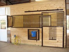 Here's a great example of our Integrity series with a swing out hay feeder, swing out water bucket holder and drop down door opening.  www.classic-equine.com