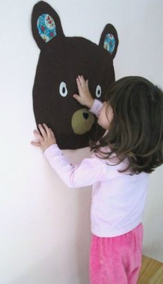 Bear Face - makes me think to make fabric faces with velcro noses, eyes, etc - like a Mr. Potato for the wall
