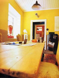 LONG TABLE YELLOW WALL