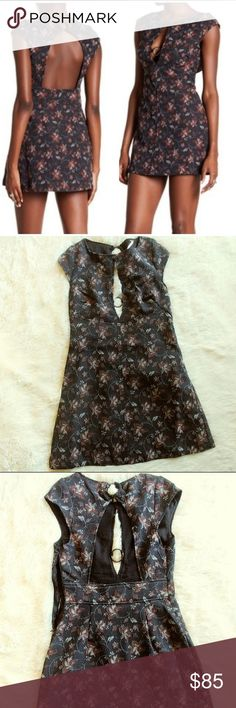 """Free People Floral Mini Dress Free People Mini Dress Cap Sleeve Crew neck Front Keyhole Back cutout Side hidden zip closure All over floral print It has a little bit of stretch. 2% spandex/elastane  98 polyester. Lining: 100% rayon  Color: black combo Size: 2 Bust: 15 1/2"""" across(flat) Lenght: 31"""" Free People Dresses Mini"""