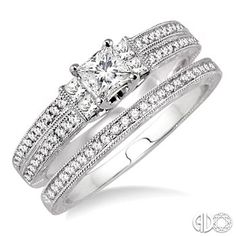 I want this one! -j.s.  5/8 Ctw Diamond Wedding Set with 1/2 Ctw Princess Cut Engagement Ring and 1/10 Ctw Wedding Band in 14K White Gold