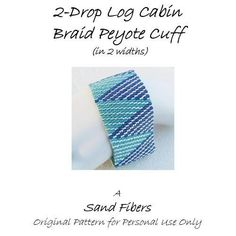2-Drop Log Cabin is eligible for Sand Fibers 3-for- 2 Pattern Program.    Purchase any two Sand Fibers patterns and receive a third, of equal or