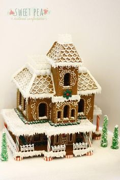 The original idea to make a gingerbread house was improved by using a delicious, rich, dark chocolate cake as a structural support on the inside. Everything is hand made and delicately decorated to make this Victorian cottage come to life.