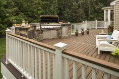 With an outdoor kitchen like this, your deck will soon become the newest gathering spot for the neighbors.