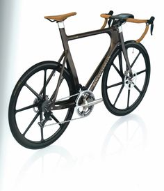 The Aston Martin ONE-77 carbon fibre bike  http://www.aston-martin.com/2012/08/07/the-one-77-collection/