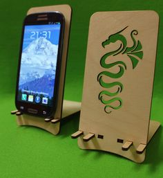 Classic Station Wooden Phone Holder Stand Samsung Galaxy S3 S4 Smartphone Dragon iPhone Dock Phone Stand Docking Station by FeelMyCraft on Etsy https://www.etsy.com/listing/170048595/classic-station-wooden-phone-holder
