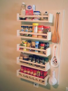 DIY spice rack. For tiny kitchens without storage space. -20x32 solid oak board 1/2 inch thick -5 Ikea Bekvam spice racks -paint + brush + screws Total cost: $50 The wooden board protects the wall and its easy to take if you move. It makes my standard kitchen look cozy.
