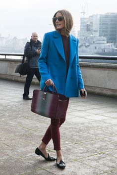 Olivia Palermo in an electric blue coat and and red ankle skinnies in London.
