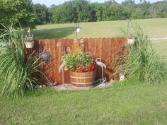 Your above ground propane tank doens't need to be an unsightly eyesore. Make your propane tank blend in with your yard with these ideas. Propane Tank Art, Propane Tank Cover, Outdoor Projects, Garden Projects, Outdoor Landscaping, Outdoor Gardens, Septic Tank Covers, Outdoor Living, Outdoor Decor