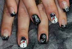 Hand painted Frosty the Snowman nails with stamped snow flakes. Acrylic base.