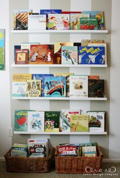 displaying books in the playroom | Jones Design Company | stylish custom designs for life they used ikea picture ledges.