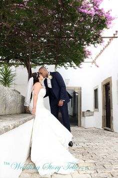 Bride and groom in old court yard at Os Agostos