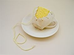 Michelle Taylor - Narrative Artefact 3 (cup & saucer, 2013) Found object, yarn, knit.