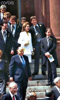 Jackie Onassis waits with her son John, Jr., on the steps of St. Matthew's Cathedral, after the marriage of her niece, Kerry Kennedy, to Andrew Cuomo. They stood on these same steps in 1963 after JFK's funeral.