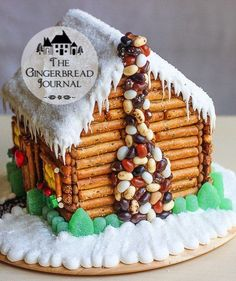 A Gingerbread House Cabin in Winter Welcome back to the Little Cabin in the Woods. It snowed! Layers of icing and sugar have taken our gingerbread log cabin from the golden warmth of Fall to the cozy snugness of a Winter's aft… Cool Gingerbread Houses, Gingerbread House Designs, Gingerbread House Parties, Gingerbread Village, Christmas Gingerbread House, Gingerbread House Decorating Ideas, Gingerbread Cookies, Homemade Gingerbread House, Graham Cracker Gingerbread House