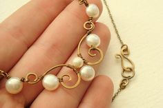 Antiqued brass scroll necklace with white freshwater button pearls - wire wrapped delicate spiral design - nice