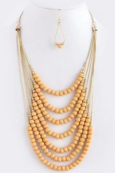 Beaded peach tiered necklace set.  Lalise www.lalise.org