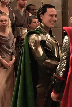 """I like the coronation scene because you get to see """"peasant"""" (or at least non-royal) fashions. It's interesting that everyone else wears more muted tones. Is it just a fashion thing or is there a rule against wearing a color someone in the royal family has claimed?"""