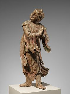 late 15th–e.17th C. Buddhist Pilgrim. Ming China. A young man in this stance of reverence is often Sudhana. In China he is linked with Guan-yin. Linden wood, pigment, lacquer, gilding; single-woodblock construction. H. 27 1/2""